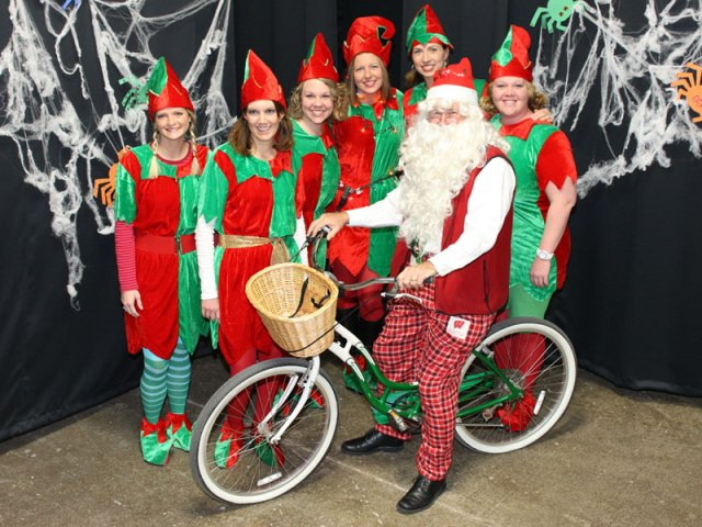 Sales dressed as Santa and his elves on Halloween